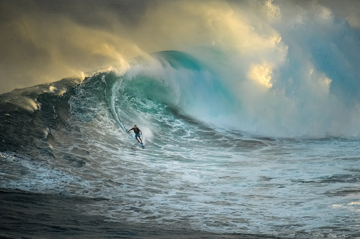 Surfer on a big wave at Jaws - gettyimageskorea