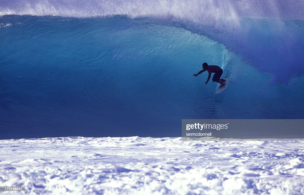 surfer on a blue wave : Stock Photo