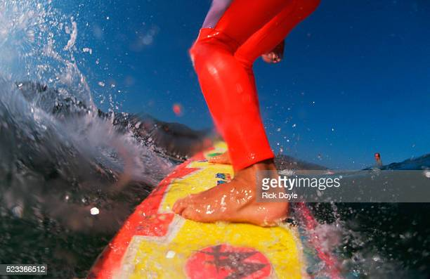 surfer on surfboard - malibu stock pictures, royalty-free photos & images