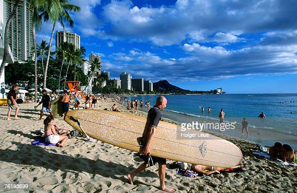 Surfer on Waikiki Beach, Oahu, Hawaii, United States of America, North America