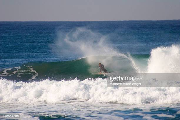 surfer on wave at ansteys beach. - durban stock pictures, royalty-free photos & images