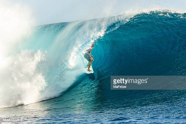 surfer owen wright surfing 2014 billabong pro tahiti - big wave surfing stock pictures, royalty-free photos & images