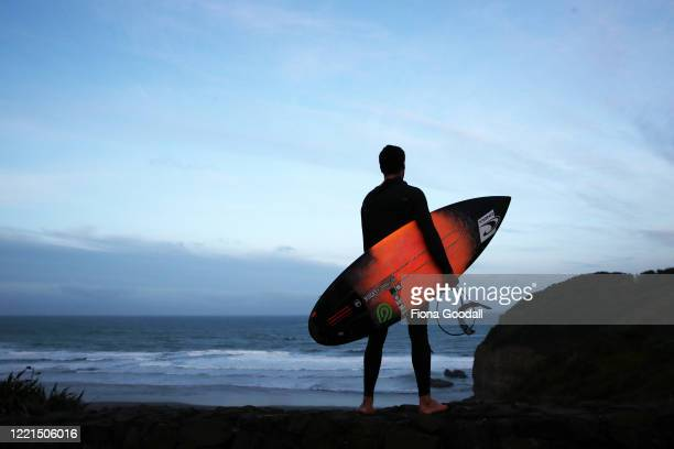 Surfer Paul Moretti 24 of Muriwai gets ready to return to the water at Maori Bay on April 28 2020 in Auckland New Zealand Today is the first day he...