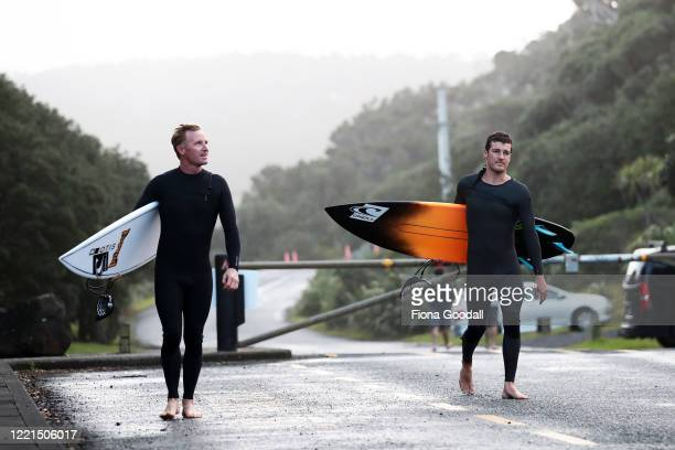 Surfer Paul Moretti 24 of Muriwai gets ready to return to the water at Maori Bay with neighbour Mike Phillips on April 28 2020 in Auckland New...