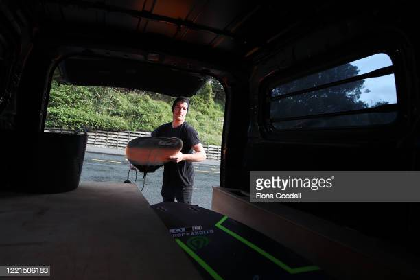 Surfer Paul Moretti 24 of Muriwai packs up his boards at Maori Bay on April 28 2020 in Auckland New Zealand Today is the first day Paul has been able...