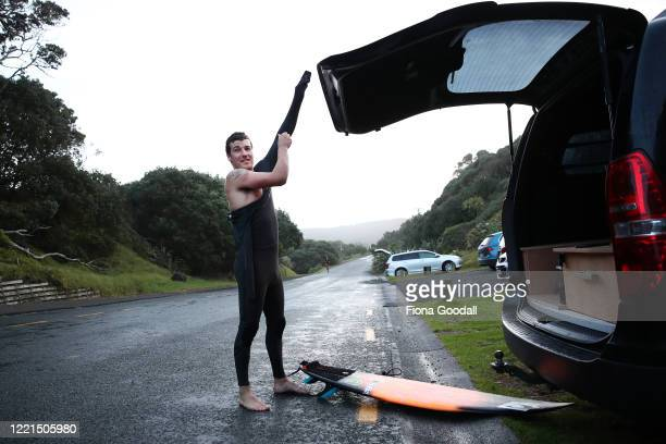 Surfer Paul Moretti of Muriwai gets ready to return to the water at Maori Bay on April 28 2020 in Auckland New Zealand Today is the first day Paul...