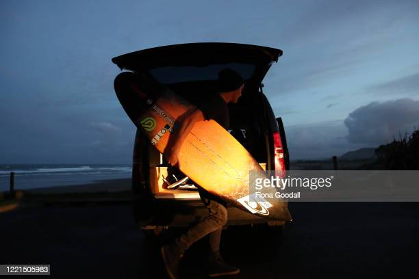 Surfer Paul Moretti of Muriwai prepares to head back into the surf at Maori Bay on April 28 2020 in Auckland New Zealand Today is the first day Paul...