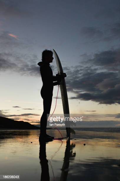 Surfer Phil Yau stands and looks out at the waves before an evening surf on October 4 2013 in Saltburn United Kingdom The surfing scene on the north...