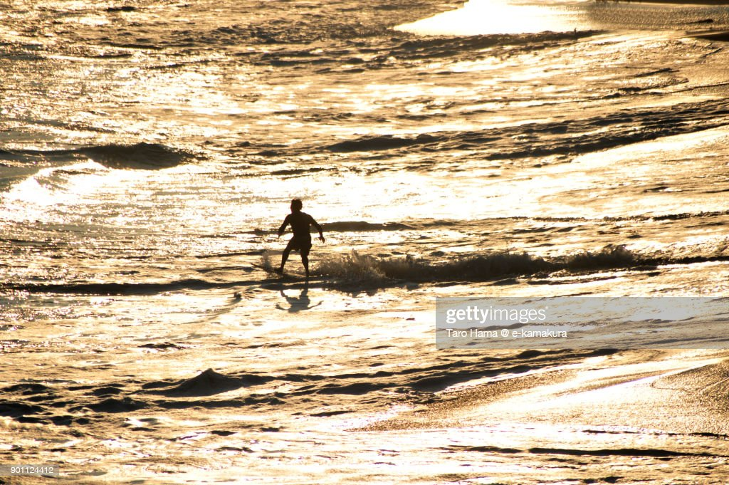 A surfer playing on the sunset beach in Kamakura city in Kanagawa prefecture in Japan : ストックフォト