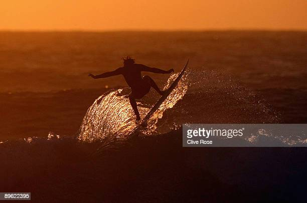 A surfer practices at dusk during the Relentless Boardmasters surfing feastival on August 5 2009 in Newquay England