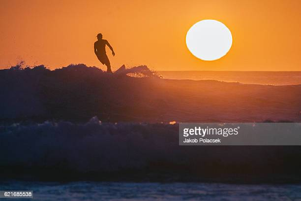 surfer pulls out of a wave