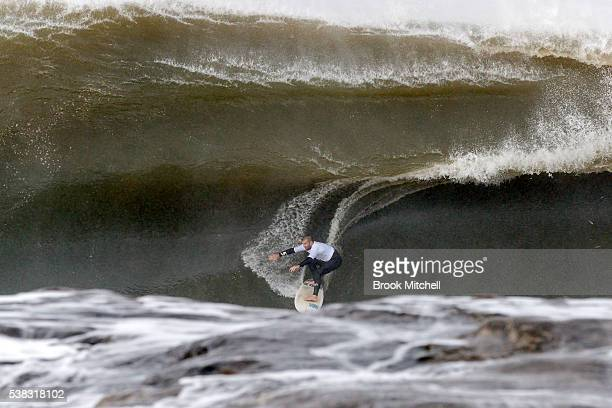 Surfer Richie Vaculik rides a huge wave during the Cape Fear contest on June 6 2016 in Sydney Australia