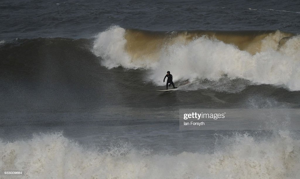 Surfers Ride Big Waves In Yorkshire