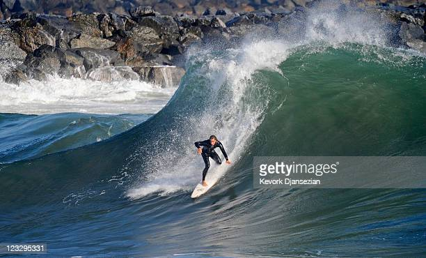 A surfer rides a high wave at The Wedge on September 1 2011 in Newport Beach California Waves measuring up to 20 feet pounded the beach A winter...