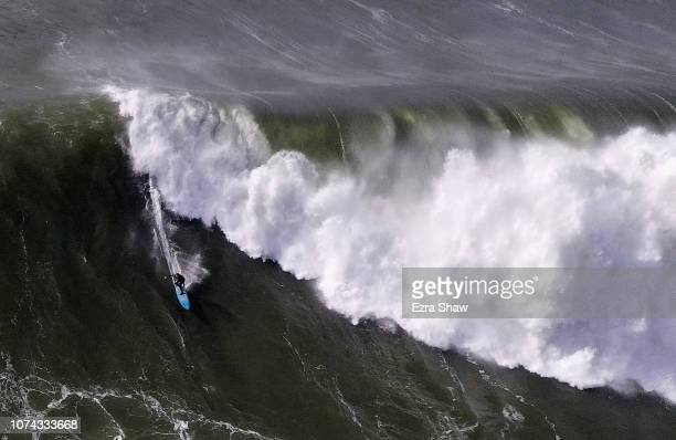 A surfer rides a wave at Mavericks on December 17 2018 in Half Moon Bay California A giant swell brought waves of up to 50 feet high to Northern...