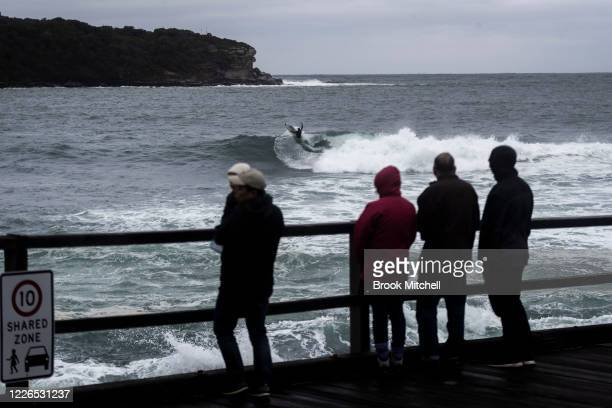 A surfer rides a wave inside Botany Bay at La Perouse on May 23 2020 in Sydney Australia Winter weather including rain and strong winds is expected...