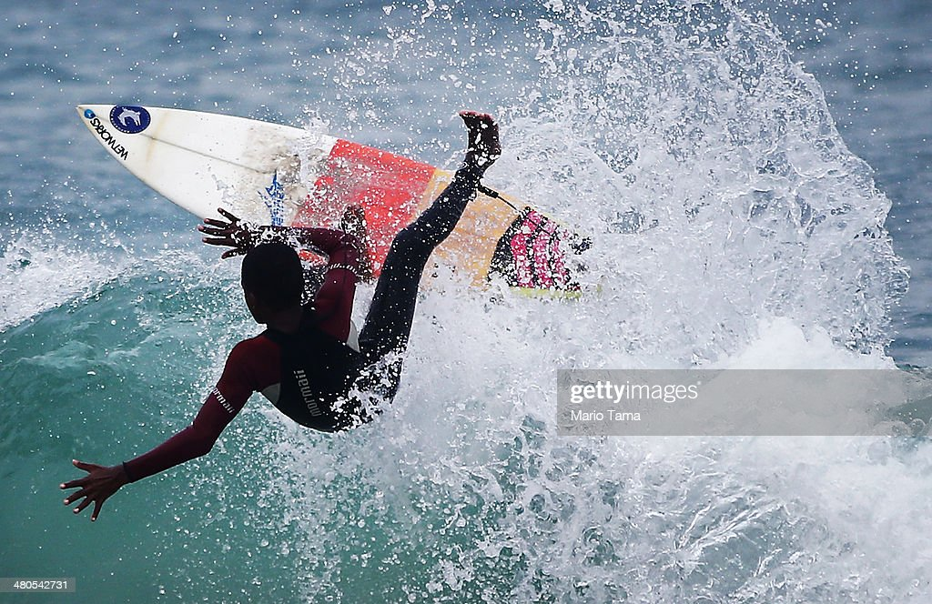 A surfer rides a wave near Arpoador Beach on March 25, 2014 in Rio de Janeiro, Brazil. Autumn has arrived in Rio bringing with it much needed rains and increased surf in some areas.