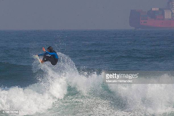 A surfer rides a wave on May 17 2015 in Viña del Mar Chile Viña del Mar will be one of the eight host cities of the Copa America Chile 2015
