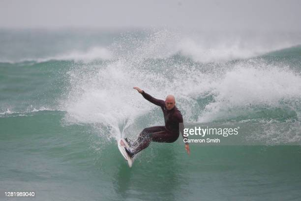 A surfer rides the waves at high tide on October 24 2020 in Portreath England