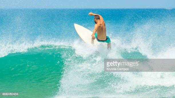 Surfer riding a wave off the top, Tamarindo and Langosta Beaches, Costa Rica