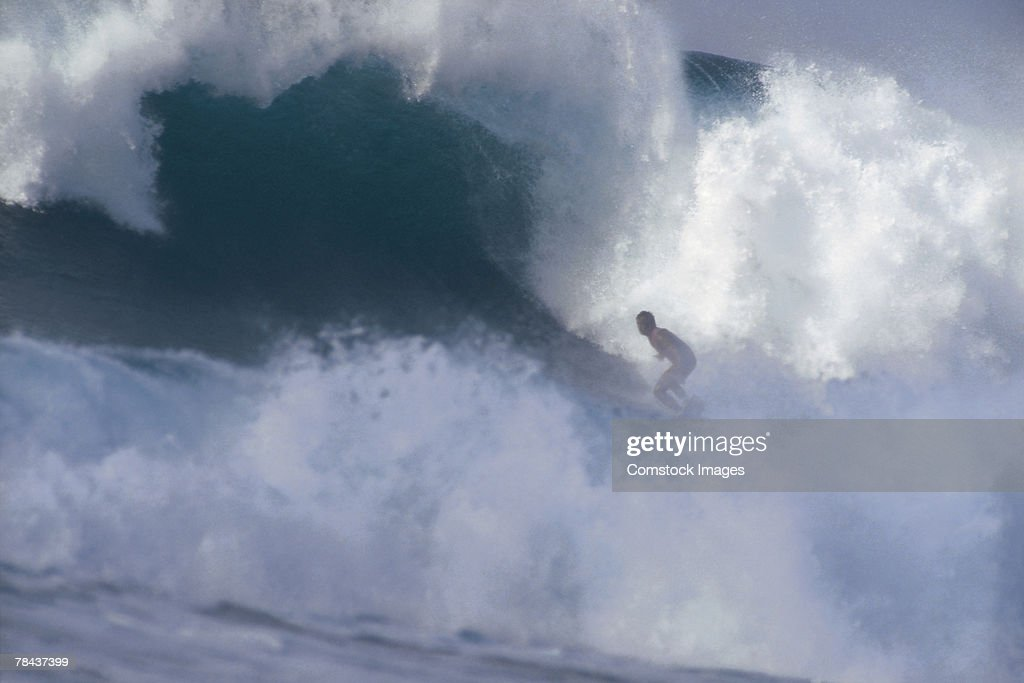 Surfer riding a wave : Foto de stock