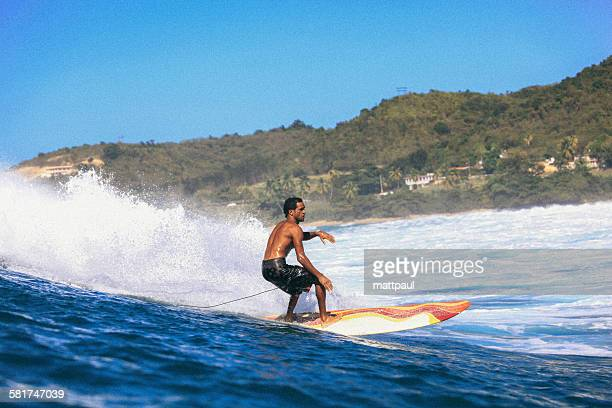 Surfer riding a wave, Puerto Rico, USA