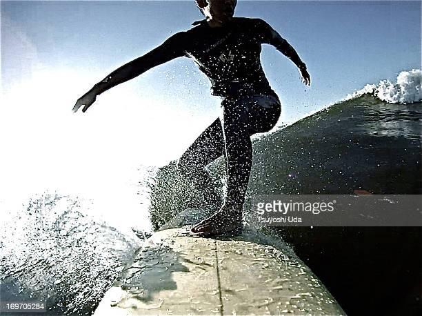 Surfer riding on crystal splashed wave