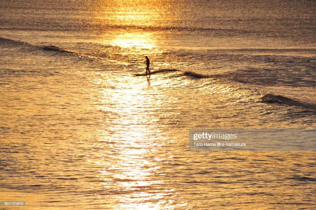 A surfer riding on morning wave in Kamakura city in Kanagawa prefecture in Japan : ストックフォト
