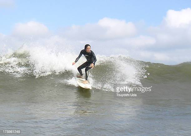 A surfer riding on small but good wave