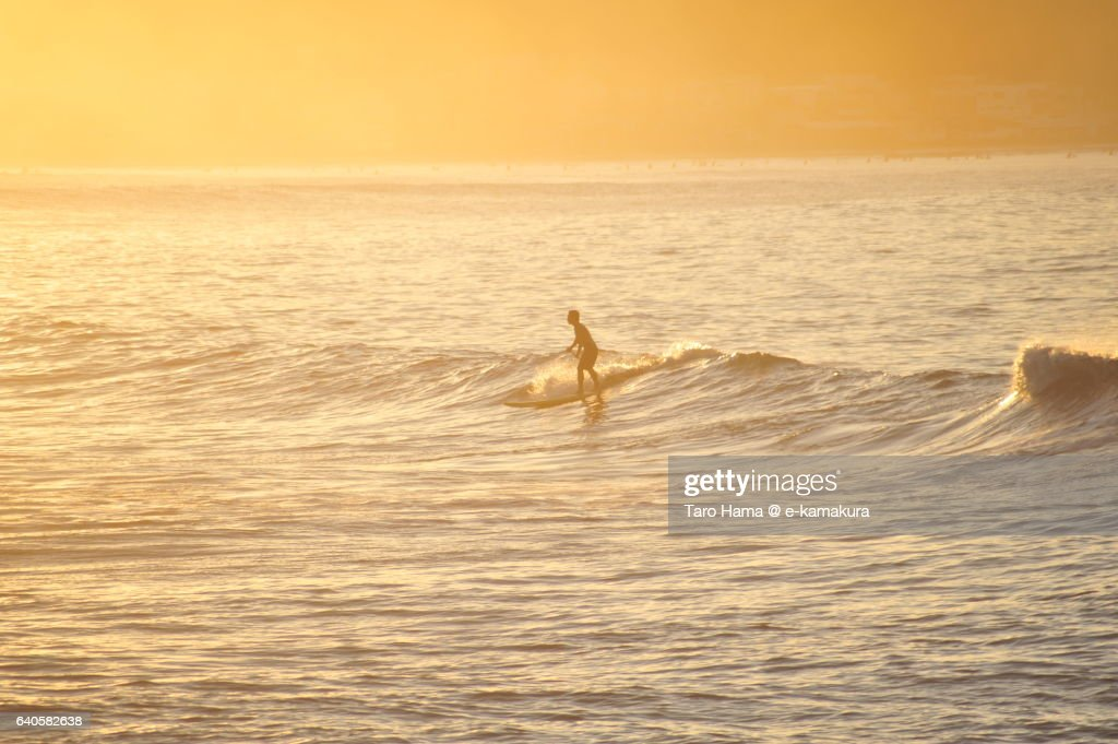 A surfer riding on the morning wave : ストックフォト