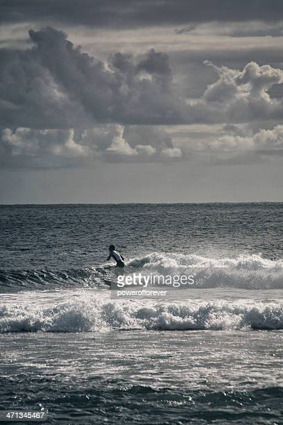 Surfer Riding Waves at Sunset on Easter Island
