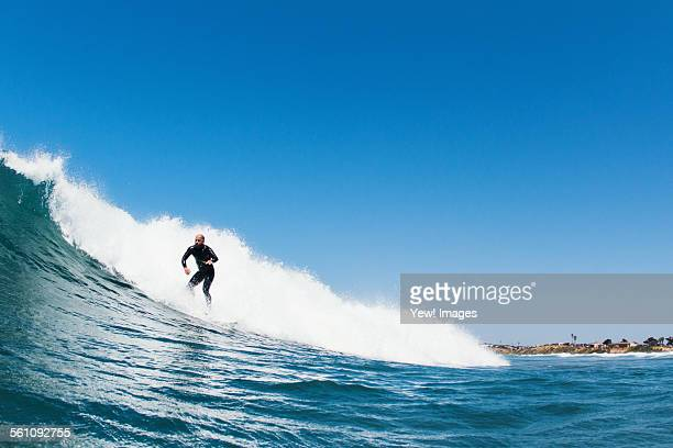 surfer riding waves in ocean, california, usa - carlsbad california stock pictures, royalty-free photos & images