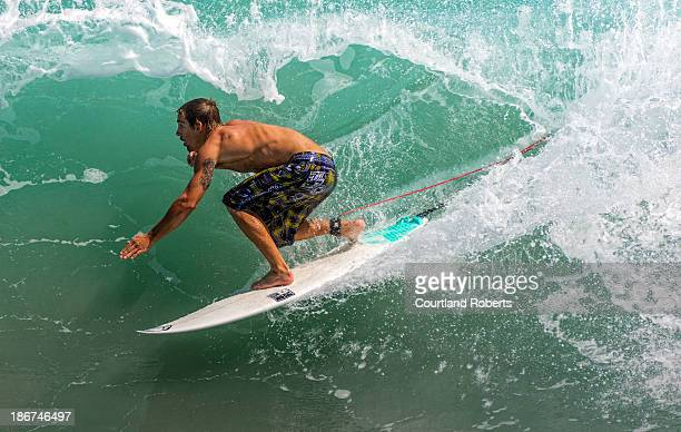 Surfer runs down the wall of a wave at the Sebastian Inlet State Park in Florida on September 29, 2013.
