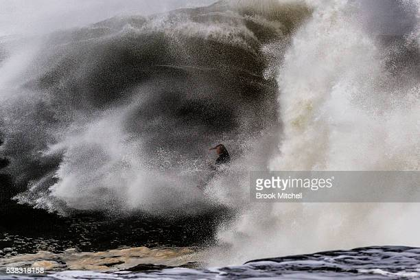 Surfer Russel Bierke wipes out on a huge waves during Cape Fear on June 6 2016 in Sydney Australia
