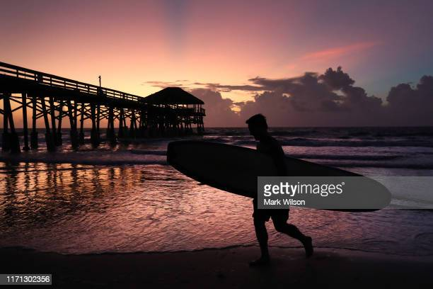 Surfer Scott Norwood prepares to go in the water as Hurricane Dorian approaches Florida on August 31 2019 in Cocoa Beach Florida Dorian could be a...
