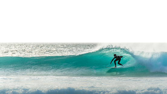 Surfer silhouette on blue wave - gettyimageskorea