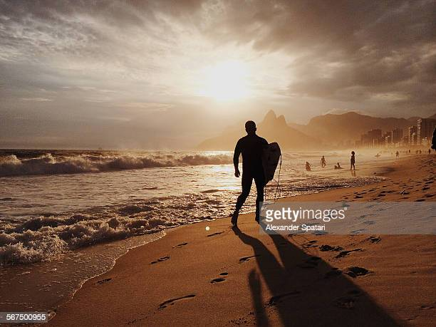 Surfer silhouette on Ipanema beach, Rio, Brazil