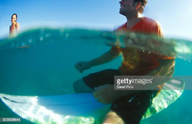 Surfer Sitting on Board
