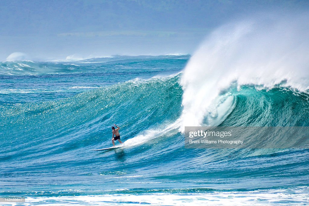 Surfer surfing in waves : Stock Photo