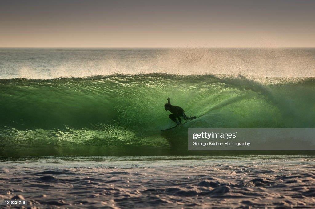 Surfer surfing on barreling wave, Crab Island, Doolin, Clare, Ireland : Stock Photo