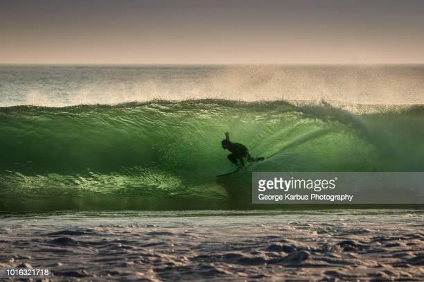 Surfer surfing on barreling wave, Crab Island, Doolin, Clare, Ireland