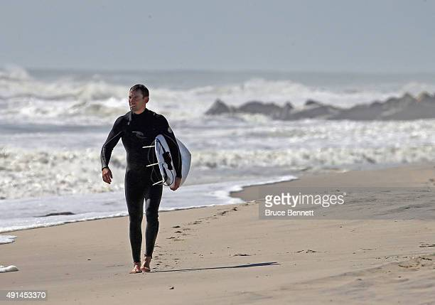A surfer surveys the five to seven foot swells coming off the Atlantic Ocean on October 5 2015 in Long Beach New York The higher than average wave...