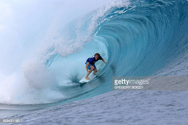 US surfer Taylor Clark competes on August 9 2014 during trials for the 2014 Billabong Pro Tahiti surf competition in the Hava'e pass off Teahupoo in...