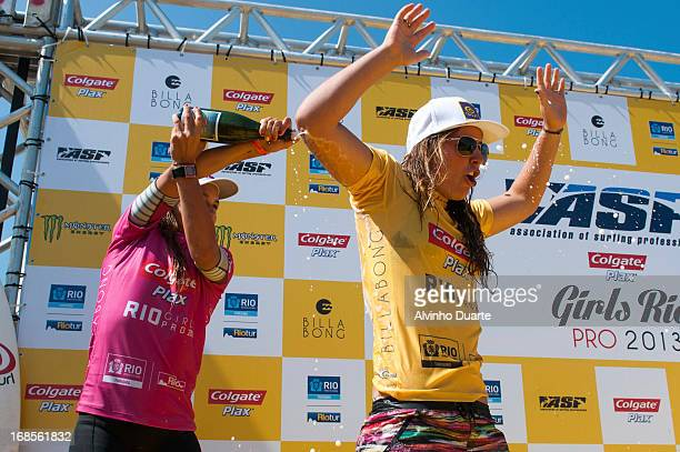 Surfer Tyler Wright celebrates her victory during the Billabong Rio Pro at Barra da Tijuca Beach on May 11 2013 in Rio de Janeiro Brazil