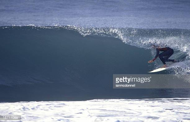 surfer under a green barrel - malibu stock pictures, royalty-free photos & images