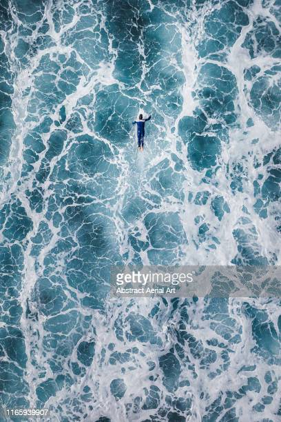 surfer waiting for the big next wave shot by drone, lanzarote - power in nature stock pictures, royalty-free photos & images