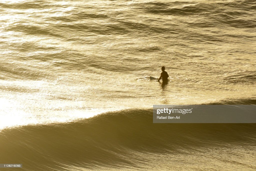 Surfer Waits for the Perfect Wave : Stock Photo