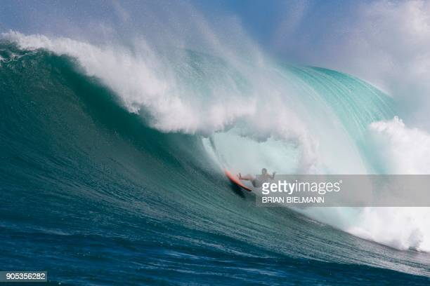 Surfer wipes out at Pe'ahi, also known as Jaws, during big wave surfing on January 14, 2018. / AFP PHOTO / brian Bielmann / RESTRICTED TO EDITORIAL...