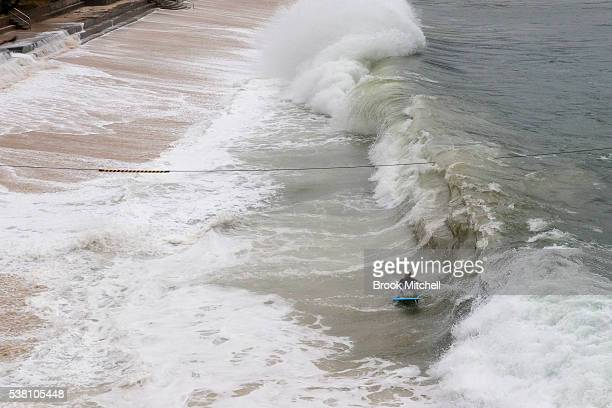 A surfer wipes out on a wave at Shark Beach Vaucluse on June 5 2016 in Sydney Australia Located inside Sydney harbour the rarely surfed waves at...