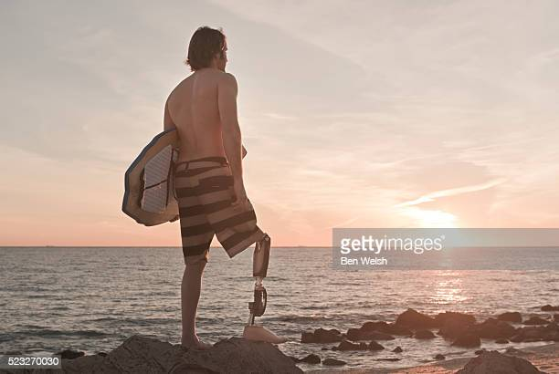 Surfer with disabled leg.